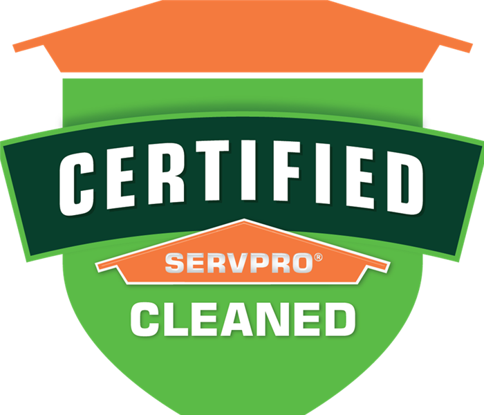 "Green and Orange shield logo with the inscription ""Certified: SERVPRO Clean"""