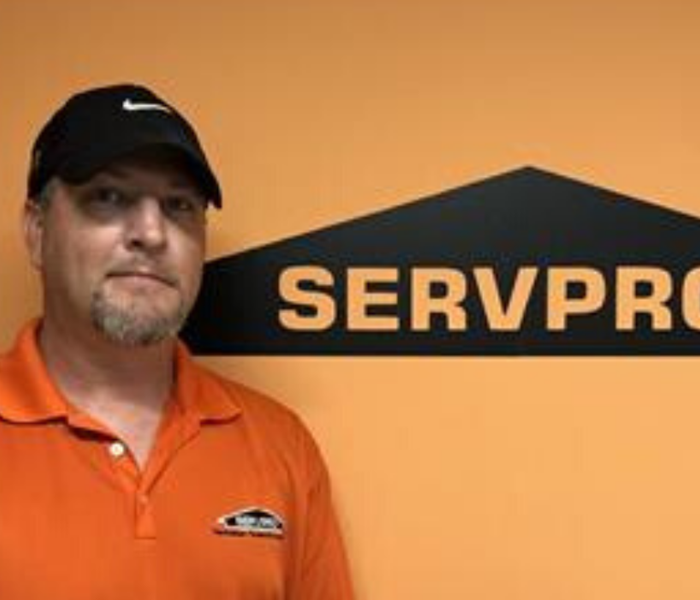 Male SERVPRO employee in a black hat