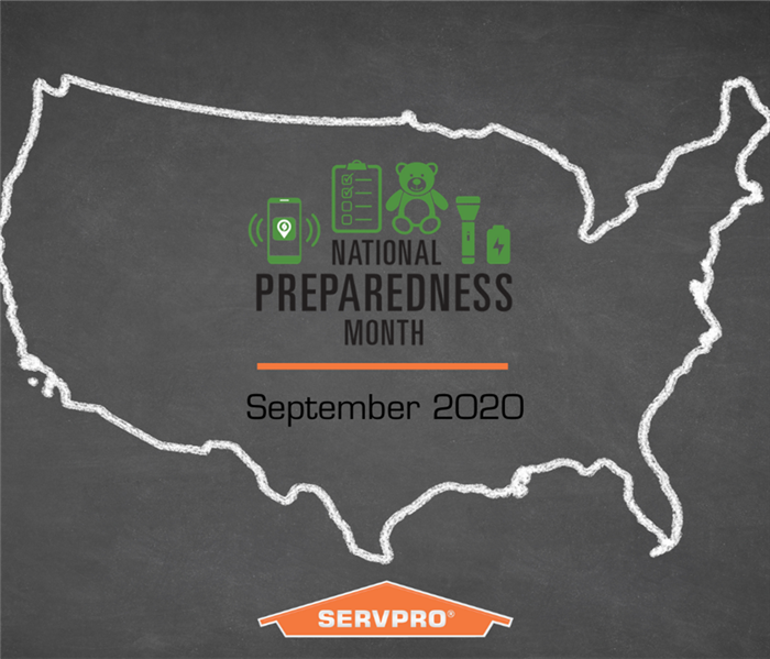 Gray background with white outline of the USA. National preparedness month logo in center with orange SERVPRO logo at bottom