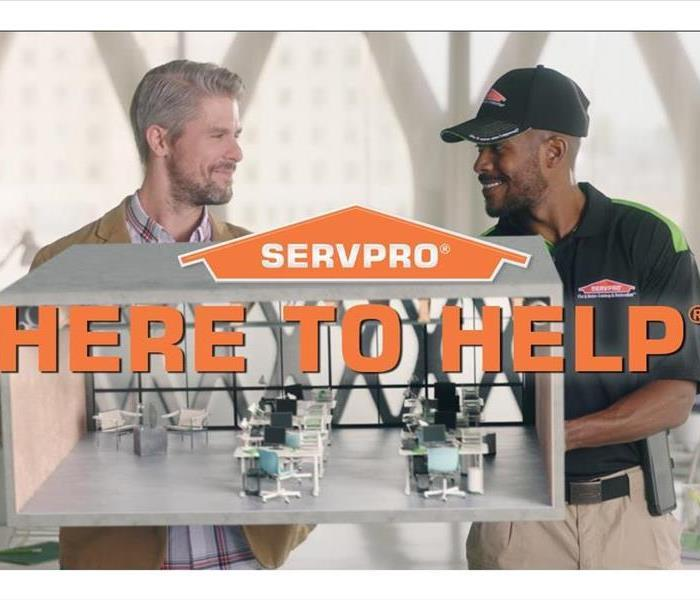 "SERVPRO employees with the tagline ""Always Here to Help"""