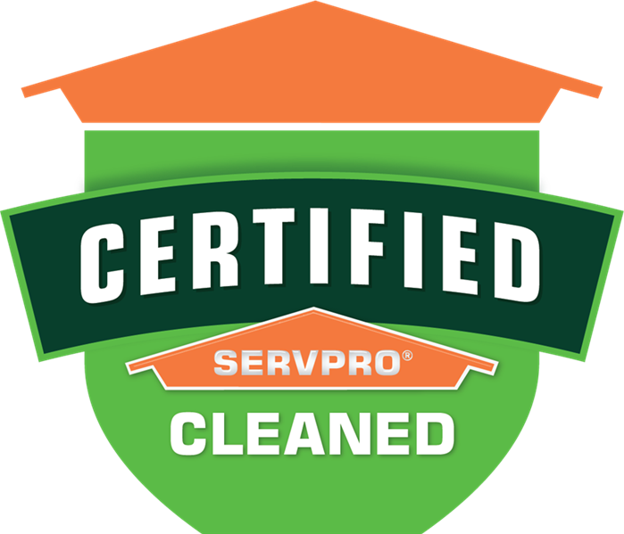 Orange and Green Certified: SERVPRO Cleaned logo, shaped like a shield