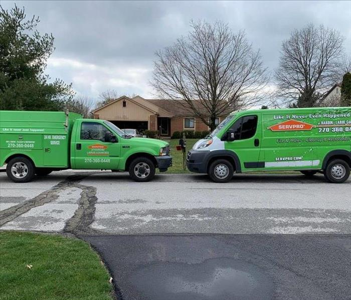 Two SERVPRO work vehicles, parked facing each other